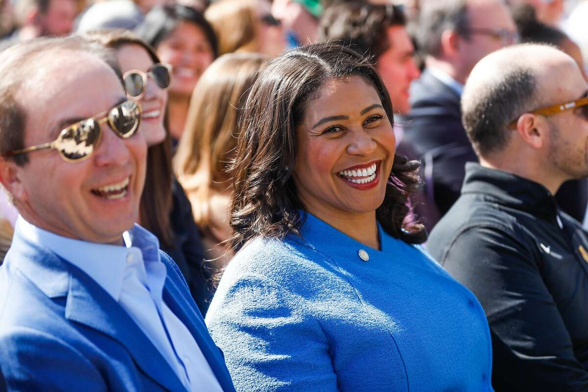 Golden State Warriors owner Joe Lacob (left) and Mayor London Breed (right) laugh press conference to announce Metallica as the first performer at the Chase Center in San Francisco, Calif., on Monday March 18, 2019.