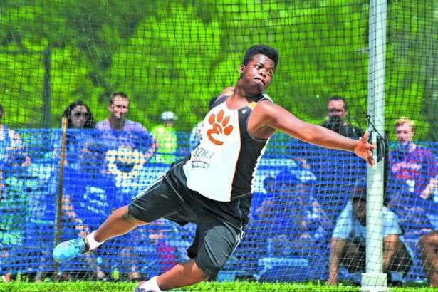 Edwardsville's Amari Brooks makes his third throw during last year's finals in the discus at the Class 3A state meet at O'Brien Stadium in Charleston.