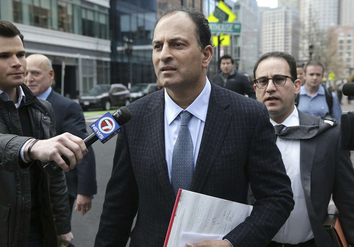 FILE -- David Sidoo, of Vancouver, Canada, leaves following his federal court hearing Friday, March 15, 2019, in Boston. Sidoo pleaded not guilty to charges as part of a wide-ranging college admissions bribery scandal.Two Bay Area parents were indicted Tuesday on charges of mail and wire fraud, as well as money laundering charges.