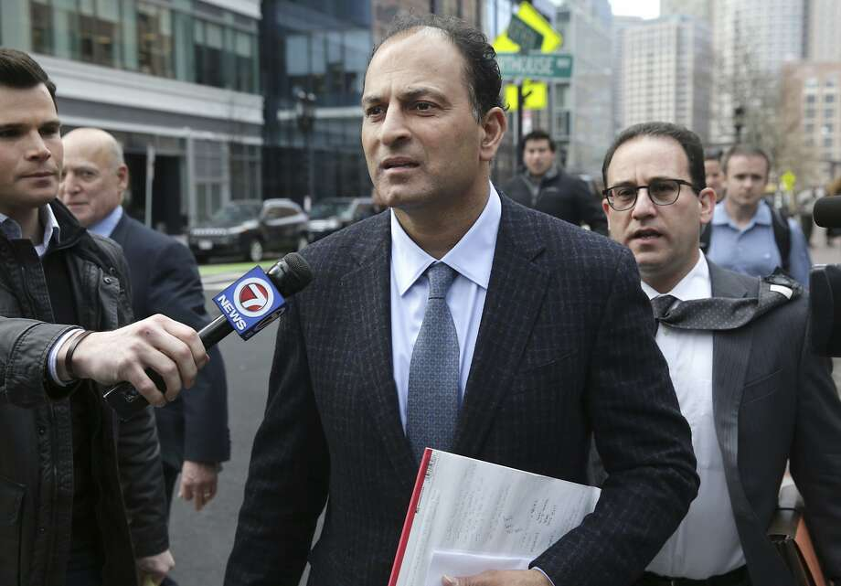 FILE -- David Sidoo, of Vancouver, Canada, leaves following his federal court hearing Friday, March 15, 2019, in Boston. Sidoo pleaded not guilty to charges as part of a wide-ranging college admissions bribery scandal.  Two Bay Area parents were indicted Tuesday on charges of mail and wire fraud, as well as money laundering charges. Photo: Jonathan Wiggs / Associated Press