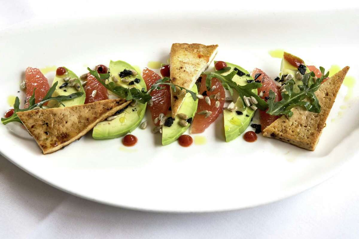 Grapefruit, avocado, tofu, soy, chili, sunflower seeds and arugula at Tris in The Woodlands