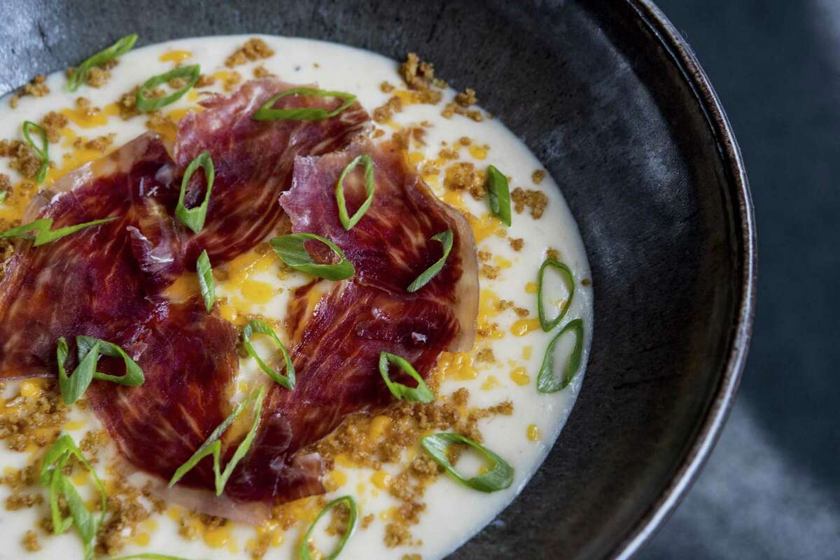 Potato soup with Iberico pork shoulder, Hook's five-year cheddar cheese and chives at Tris in The Woodlands