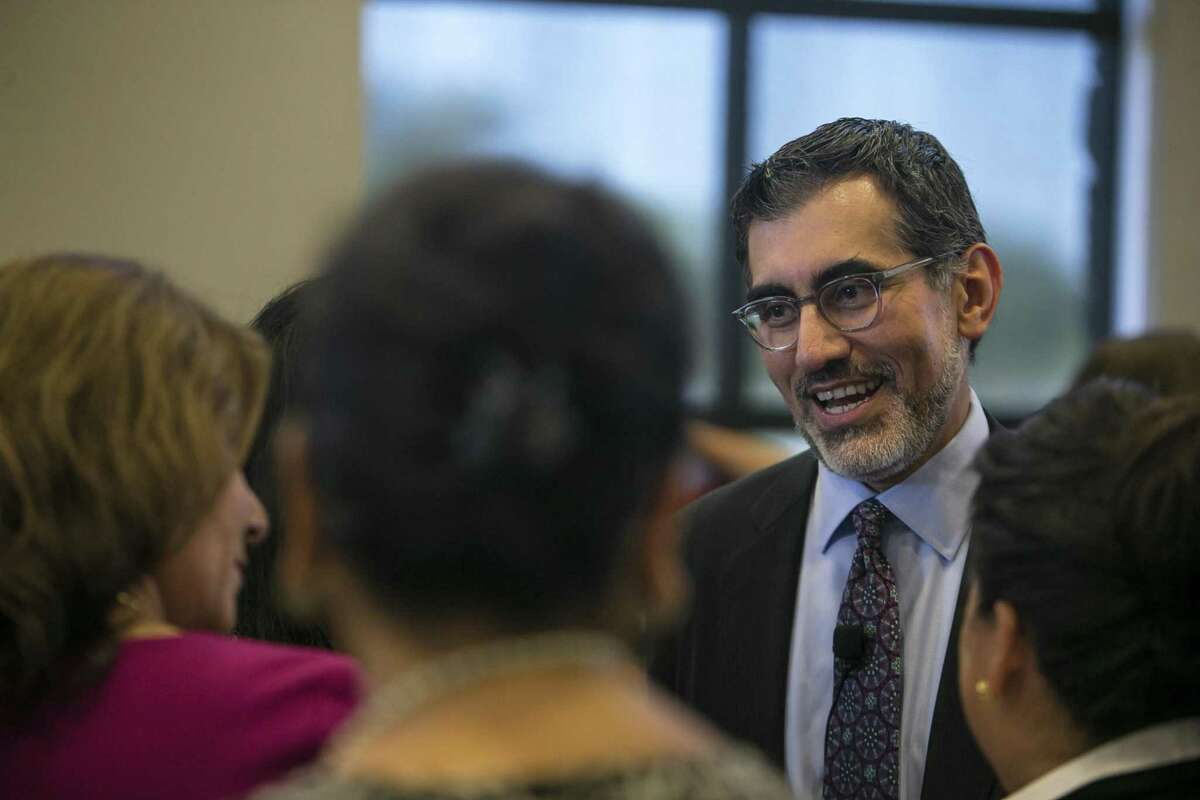 Mike Flores meets with attendees at a Hispanic Chamber luncheon last October, shortly after his appointment as Chancellor of the Alamo Colleges.