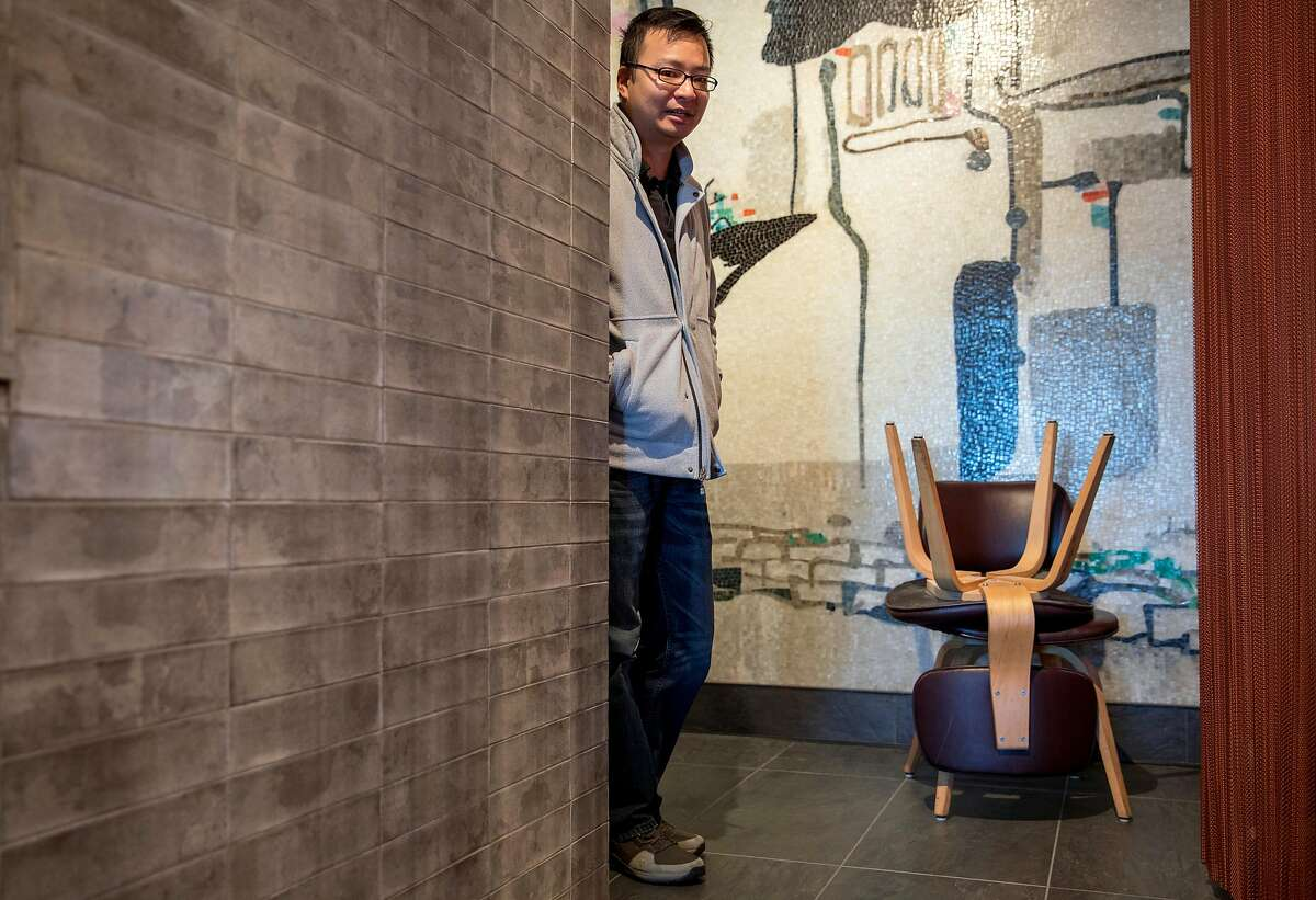 Palette Tea House manager Dennis Leung displays the chairs originally used by the restaurant that were deemed unfit by a fire inspector while at Palette Tea House located inside Ghirardelli Square in San Francisco Calif. Friday, March 15, 2019.