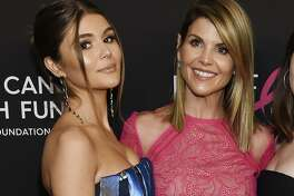 "Lori Loughlin poses with her daughter Olivia Jade Giannulli, left, at the 2019 ""An Unforgettable Evening"" in Beverly Hills, Calif., Feb. 28, 2019. A reader is glad they were finally caught and looks forward to more media coverage."