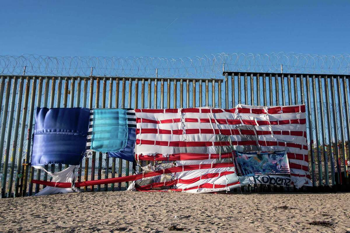 A patchwork representing a U.S. flag hangs on the U.S.-Mexico border in Playas de Tijuana, Mexico, March 8. A reader says without proficiency in Spanish or knowledge of Mexican politics, the border wall is just a Band-Aid.