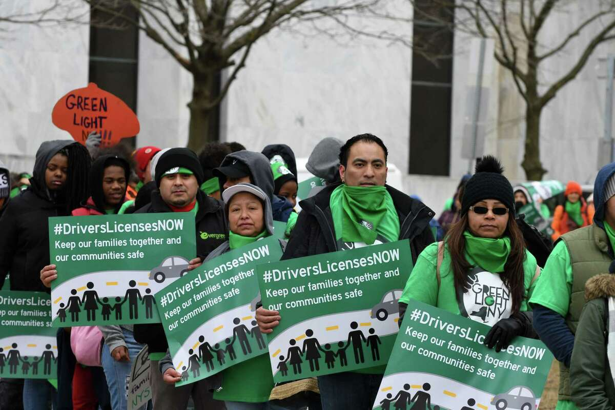 Protesters with the Green Light Campaign to get driver licenses for undocumented immigrants, march around the Capitol before holding a rally in West Capitol Park on Tuesday, March 12, 2019, in Albany, N.Y. New York currently bars immigrants from obtaining a license due to their immigration status. (Will Waldron/Times Union)