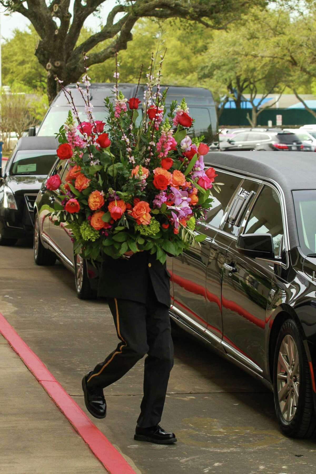 Removing flower arrangements from Congregation Beth Israel after the services for Houston philanthropist Lester Smith.