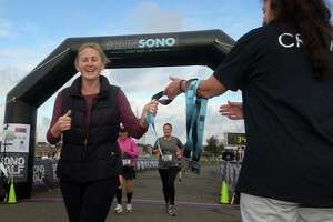 """Stamford resident Stephanie McLaughlin finishes the SONO Half Marathon and 5k Saturday, October 20, 2018, in Norwalk, Conn. However, the Traffic Authority threatened the race's future calling it a """"burden"""" and a """"concern."""""""