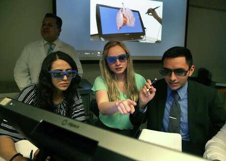 UTSA students Nayely Kova, left to right, Lyndsay Millican and Michael Medina wear 3D glasses while they use the zSpace virtual reality program on March 14, 2019. UTSA held a virtual reality anatomy conference that enabled premed and predental students to virtually dissect organs.