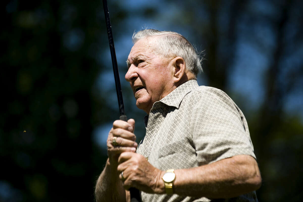 The late Newt Mapes watches his drive during a round of golf at Currie Municipal Golf Course in this May 19, 2010 file photo.