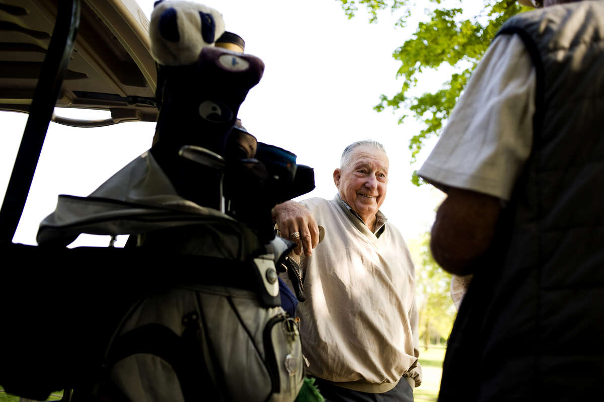Newt Mapes, then 87, chats with his golf partner George Barber after a round of golf in this May 19, 2010 file photo. Mapes passed away Sunday at the age of 96.