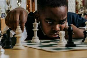 Tanitoluwa Adewumi, 8, the newly-crowned state chess champion for kindergarten through third grade, at Public School 116 in Manhattan, March 14, 2019. Tani, whose family fled northern Nigeria in 2017 in fear of attacks by Boko Haram terrorists on Christians, learned chess only a year ago and is living with his family in a homeless shelter. (Christopher Lee/The New York Times)
