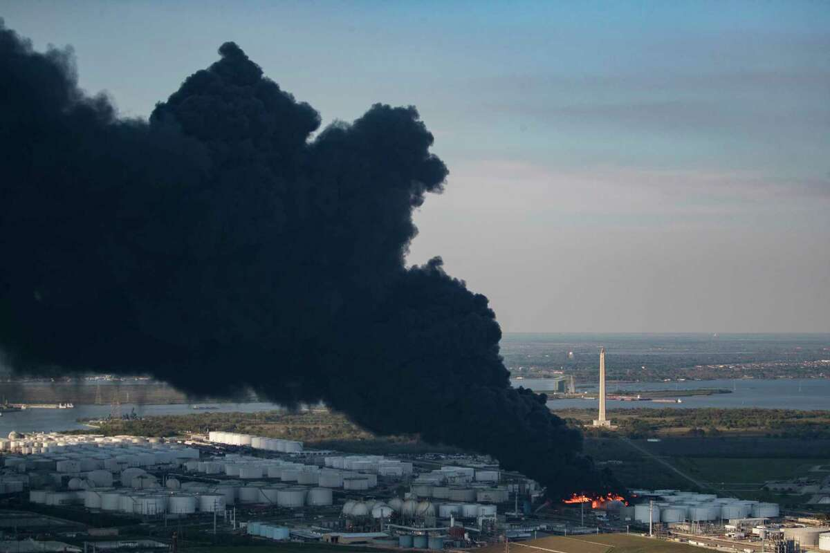 Aerial view of a petrochemical fire at a Deer Park plant on Monday, March 18, 2019, in Deer Park. The San Jacinto Monument can be seen in the background.
