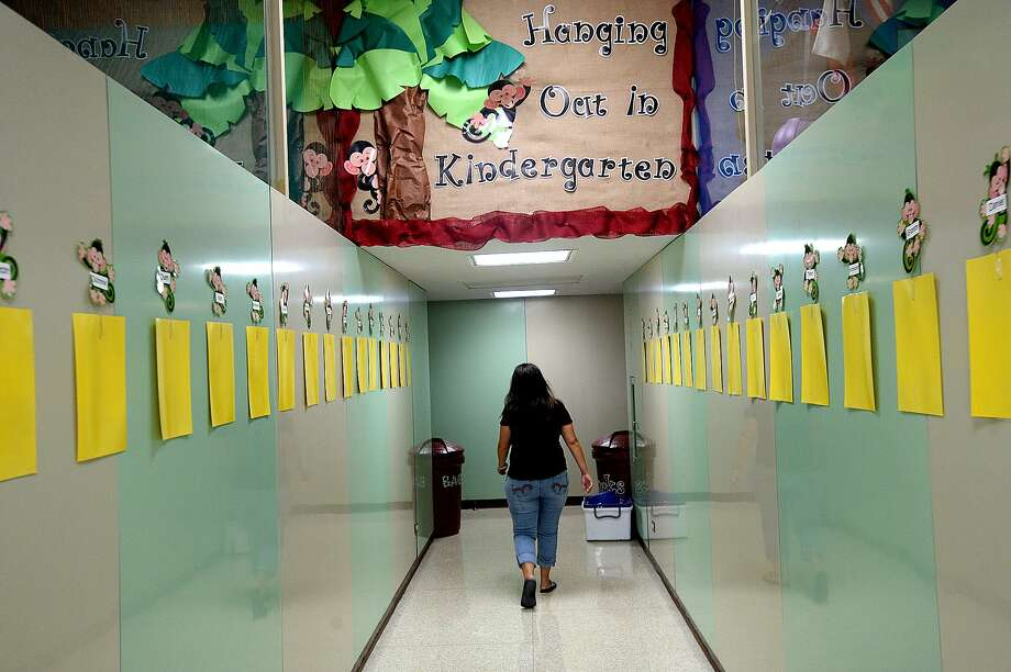 "Kindergarten teacher Paula Ryder makes her way to her classroom as she and fellow teachers and staff at Taft Elementary prepare for the upcoming school season. Taft is among the eleven District 5 ""Districts of Innovation"" schools that will be starting earlier than the August 28 general state school start.  Photo taken Tuesday, July, 25, 2017 Kim Brent/The Enterprise Photo: Kim Brent / Kim Brent / Beaumont Enterprise / BEN"