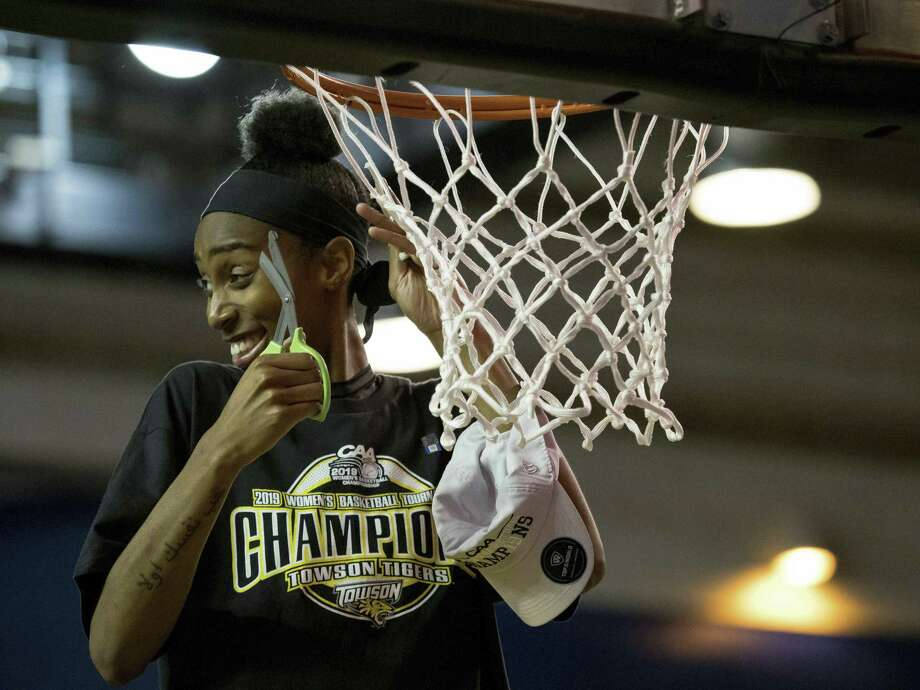 Towson forward Nukiya Mayo (1) cuts the net after their win in the Colonial Athletic Association championship. Photo: Suchat Pederson / Associated Press / Copyright 2019 The Associated Press. All rights reserved.