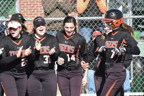 Edwardsville's Jayna Connoyer, right, is greeted by her teammates after hitting a homer in the second inning against Gillespie.