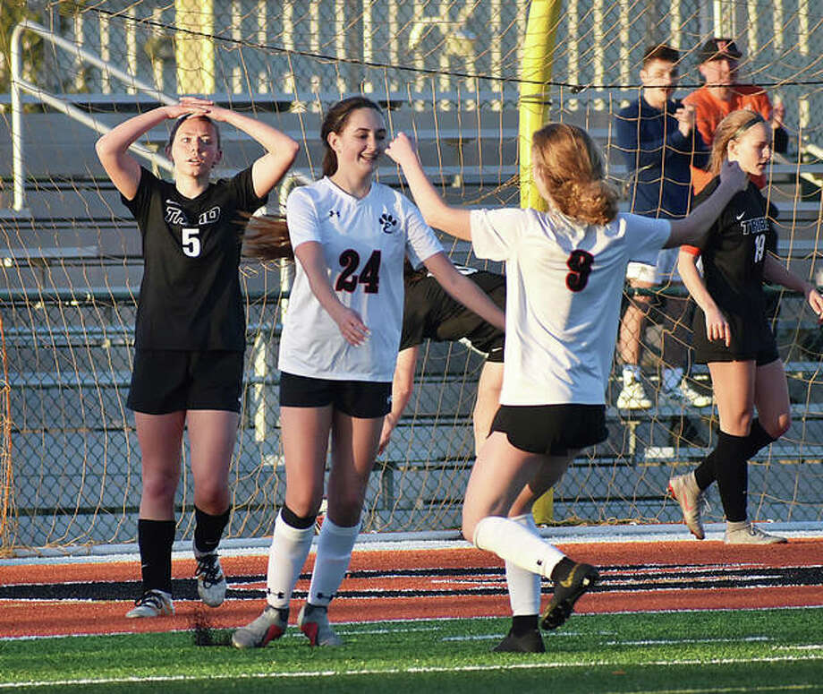 Edwardsville's Payton Federmann, right, celebrates after Rileigh Kuhns scores the second goal of the game in the 35th minute. Photo: Matthew Kamp/ The Intelligencer
