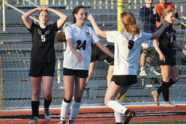 Edwardsville's Payton Federmann, right, celebrates after Rileigh Kuhns scores the second goal of the game in the 35th minute.