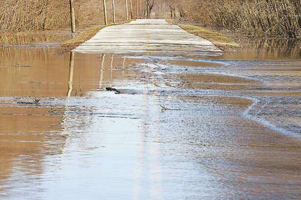Water was rushing across Villa Alta Road outside of West Alton, Missouri, Monday and was within less than two feet of the shoulder of Missouri Highway 94, not far away.