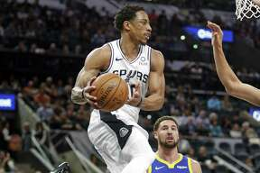DeMar DeRozan #10 of the San Antonio Spurs looks to pass after driving the lane. Golden State Warriors v San Antonio Spurs on Monday, March 18 , 2019.