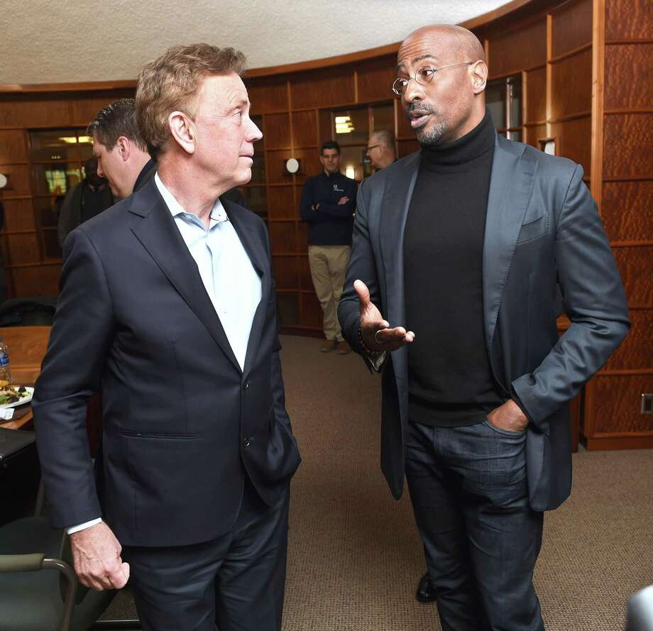 Gov. Ned Lamont speaks with CNN host Van Jones before a roundtable discussion about criminal justice reform at Quinnipiac University in Hamden on Monday. Photo: Arnold Gold / Hearst Connecticut Media / New Haven Register