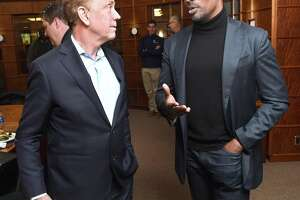 Gov. Ned Lamont speaks with CNN host Van Jones before a roundtable discussion about criminal justice reform at Quinnipiac University in Hamden on Monday.