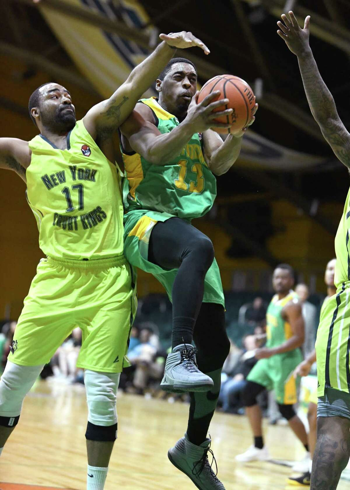 Albany Patroons' Steven Cunningham drives to the net guarded by New York Court Kings' Jerrome Jones during a basketball game at the Washington Avenue Armory on Monday, March 18, 2019 in Albany, N.Y. (Lori Van Buren/Times Union)
