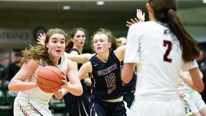 CambridgeOs Fiona Mooney , left, passes the ball to teammate Sophie Phillips (2) in the New York State Public High School Athletic Association girls' Class C championship basketball game Saturday, March 16, 2019, in Troy, N.Y.  Cambridge won 57-43. (Hans Pennink / Special to the Times Union)
