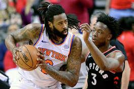 Toronto Raptors forward OG Anunoby (3) shadows New York Knicks centre DeAndre Jordan (6) during first half NBA basketball action in Toronto, Monday, March 18, 2019. (Frank Gunn/The Canadian Press via AP)