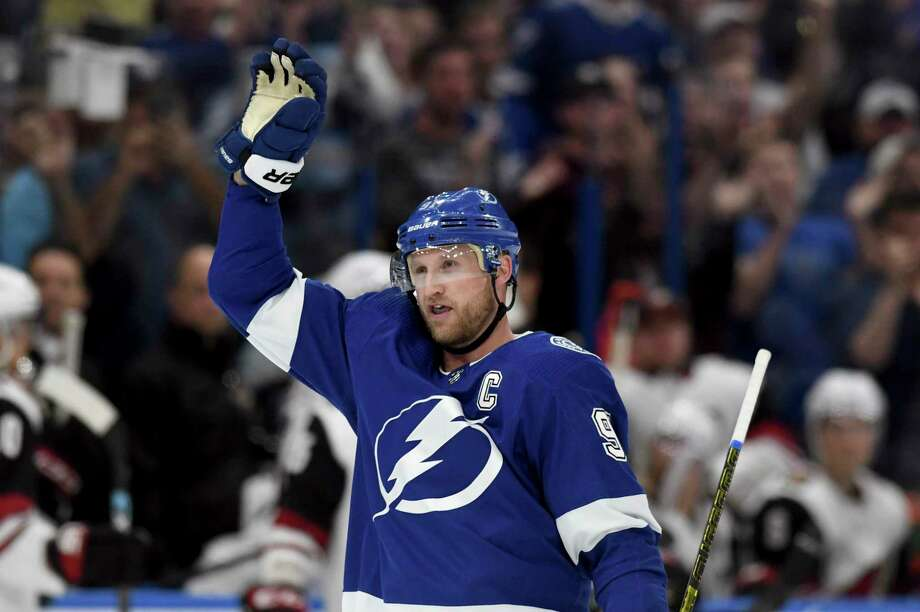 Tampa Bay Lightning center Steven Stamkos (91) waves to the crowd after becoming the all-time franchise goal leader (384) with his first-period goal during an NHL hockey game against the Arizona Coyotes, Monday, March 18, 2019, in Tampa, Fla. (AP Photo/Jason Behnken) Photo: Jason Behnken / Copyright 2019 The Associated Press. All rights reserved.
