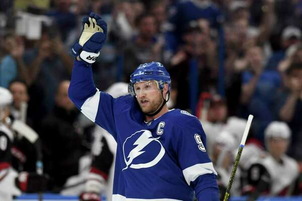 Tampa Bay Lightning center Steven Stamkos (91) waves to the crowd after becoming the all-time franchise goal leader (384) with his first-period goal during an NHL hockey game against the Arizona Coyotes, Monday, March 18, 2019, in Tampa, Fla. (AP Photo/Jason Behnken)