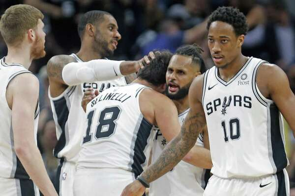 Marco Belinelli (18) endears himself to his Spurs teammates by hitting a 3-pointer Monday night. Belinelli contributed nine points off the bench.