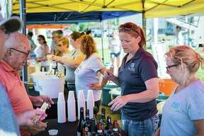 Vendors sell beer and wine samples at the Circle Wine Garden in August 2018 in Midland's City Center. (Photo provided)