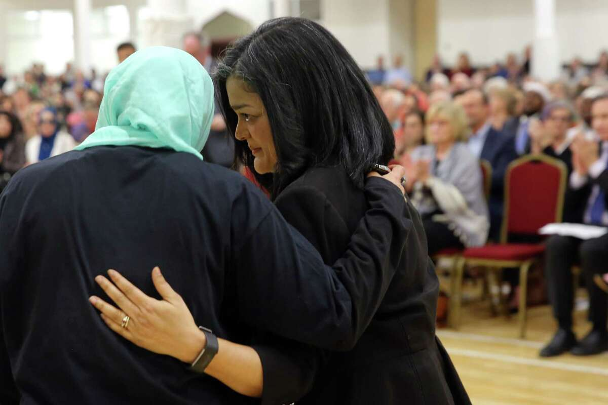 Executive Director of MAPS-AMEN Aneelah Afzali and U.S. Rep. Pramila Jayapal embrace as hundreds attend an interfaith vigil and anti-islamophobia teach-in at the Muslim Association of Puget Sound, held in response to last week's mass-shooting in Christchurch, New Zealand, Monday, March 18, 2019.