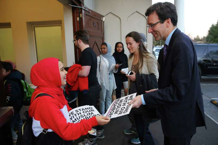 """Washington State Attorney General Bob Ferguson, right, seeks a court injunction to block Trump administration abortion """"gag Rule"""" from taking effect on May 3. Photo: Genna Martin / seattlepi.com"""