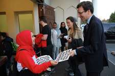 Washington State Attorney General Bob Ferguson, right, arrives at an interfaith vigil and anti-islamophobia teach-in at the Muslim Association of Puget Sound, held in response to last week's mass-shooting in Christchurch, New Zealand, Monday, March 18, 2019.
