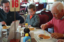 Three generations - from left, Dan Savage, Raymond Savage and Chuck Savage - share breakfast together Monday at the annual Kiwanis Pancake and Sausage Day. The event ran all day at the MacMurray College McClelland Dining Hall, and also offered drive-through and business delivery.