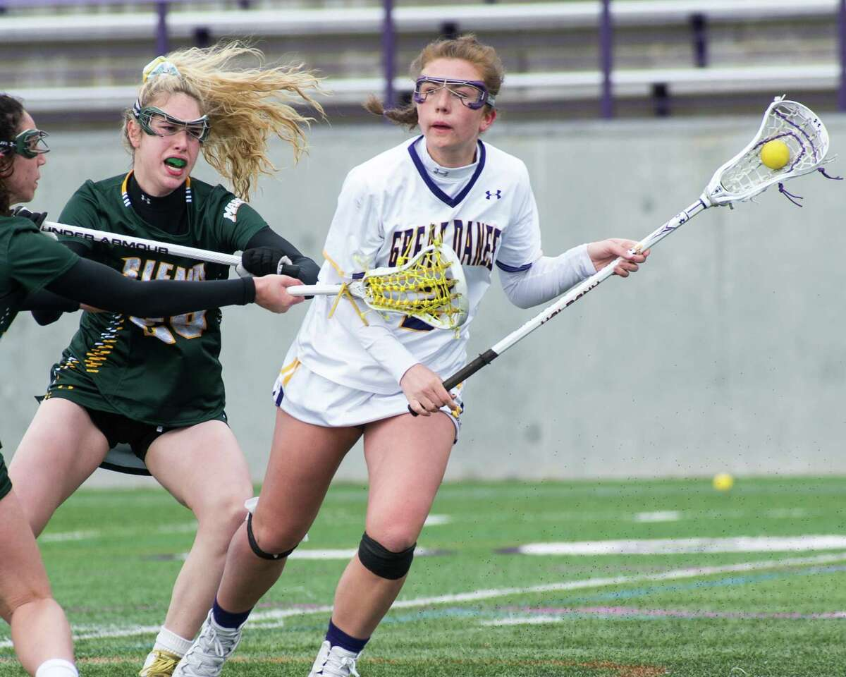 University at Albany sophomore Kendra Harbinger evades two Siena defenders at Casey Stadium on Saturday, March 16, 2019. (Jim Franco/Special to the Times Union)