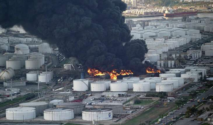 A plume of smoke rises from a petrochemical fire at the Intercontinental Terminals Company Monday, March 18, 2019, in Deer Park, Texas. The large fire at the Houston-area petrochemicals terminal will likely burn for another two days, authorities said Monday, noting that air quality around the facility was testing within normal guidelines. (AP Photo/David J. Phillip)