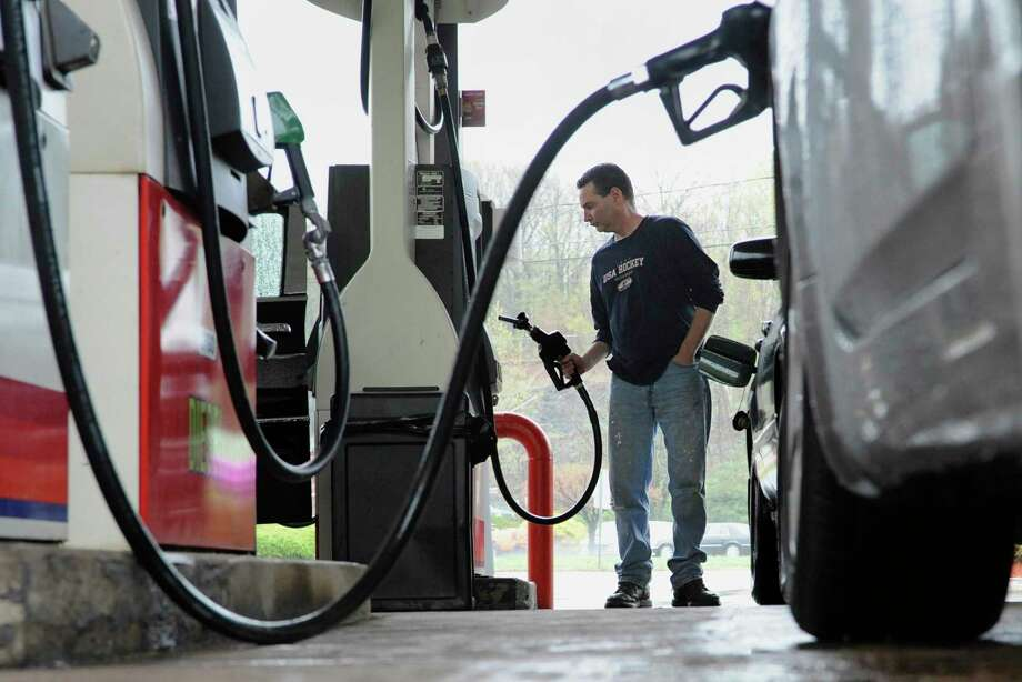 The gas tax is at the core of the argument about whether to bring tolls back to Connecticut highways. Photo: File Photo / AP2011; AP Photo/Jessica Hill