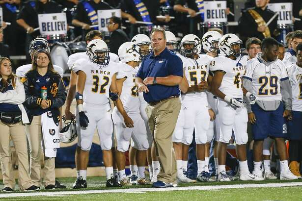 Cy Ranch head coach Gene Johnson paces the sidelines as the Mustangs tried to keep up with the Katy Tigers in the 6A DII Area playoffs at Tully Stadium on November 20, 2015.