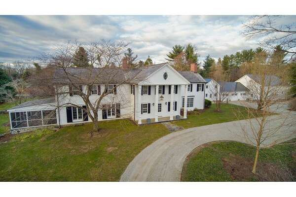 The 2.62-acre property at 2228 North Street includes an updated vintage house and horse amenities including a barn and paddocks.