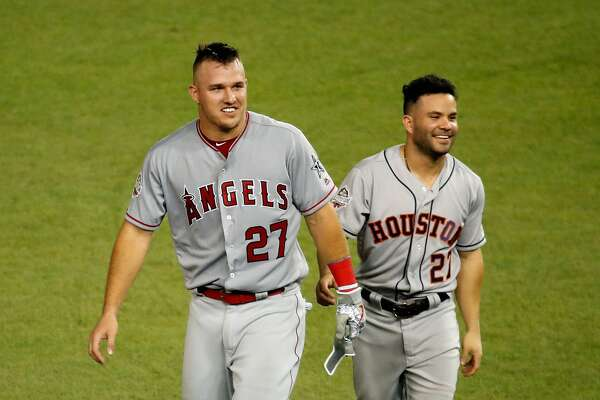 WASHINGTON, DC - JULY 17: Jose Altuve #27 of the Houston Astros and the American League and Mike Trout #27 of the Los Angeles Angels of Anaheim and the American League react in the fifth inning against the National League during the 89th MLB All-Star Game, presented by Mastercard at Nationals Park on July 17, 2018 in Washington, DC. (Photo by Patrick McDermott/Getty Images)