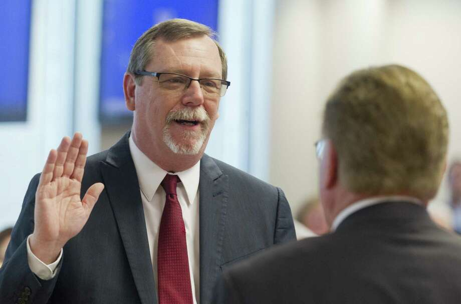 B.D. Griffin is sworn in as interim Montgomery County Attorney during a Montgomery County Commissioners Court meeting at the Alan B. Sadler Commissioners Court Building, Tuesday, March 19, 2019, in Conroe. Griffin will serve the remainder of J D Lambright's unexpired term, which is schedule to end in 2020, following Lambright's death on March 9. Photo: Jason Fochtman, Houston Chronicle / Staff Photographer / © 2019 Houston Chronicle