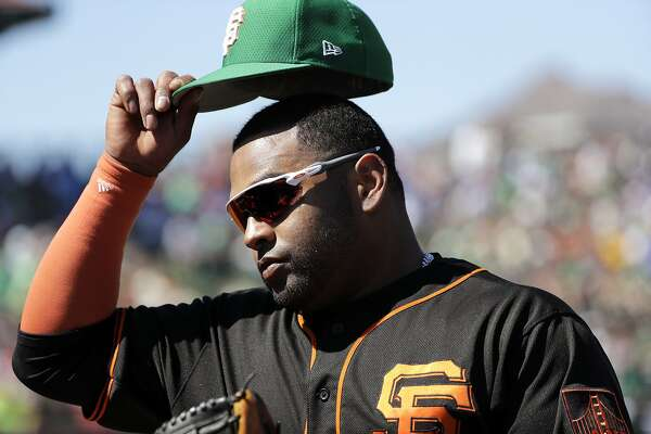 9108185c2 1of22San Francisco Giants  Pablo Sandoval pulls off his cap as he heads  into the dugout during a spring training baseball game Sunday