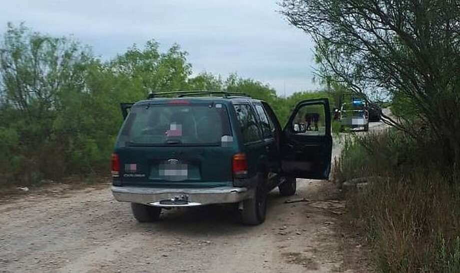 Tamaulipas state police said this is the green Ford Explorer that led them on a chase on Friday. Authorities then discovered the vehicle abandoned but loaded with 10 bundles of marijuana. The contraband weighed 661 pounds. Photo: Courtesy