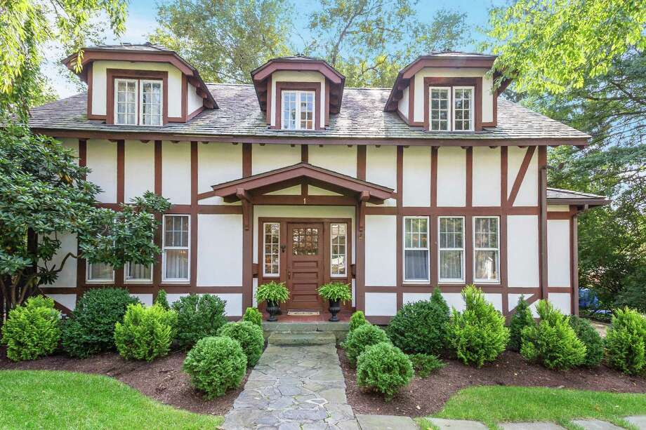 The 1900 Tudor-styled home has four-bedrooms, three baths and 2,165 square feet of living space. Photo: Halstead Connecticut / ONLINE_CHECK