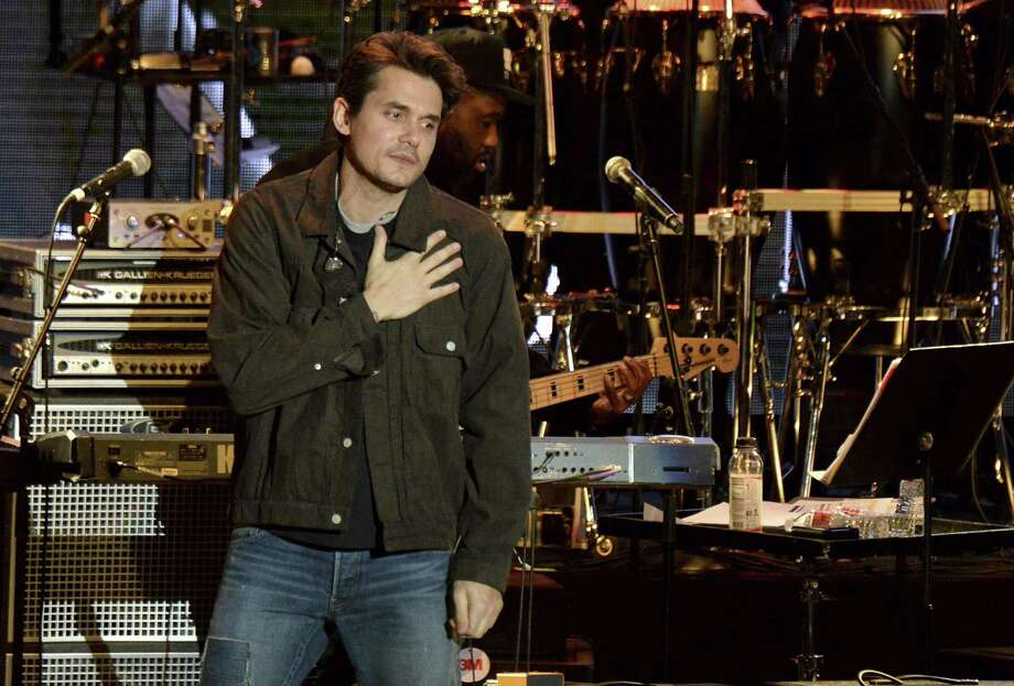 FILE - In this Oct. 31, 2018 file photo, John Mayer gestures to the crowd during the tribute event Mac Miller: A Celebration of Life at the Greek Theatre in Los Angeles. Mayer is launching a foundation focused on improving the health of veterans through scientific research. The singer on Friday, March 1, 2019 announced The Heart and Armor Foundation, which plans to focus on veterans with post-traumatic stress and meeting the emerging needs of women veterans. (Photo by Amy Harris/Invision/AP, File) Photo: Amy Harris / Associated Press / Invision