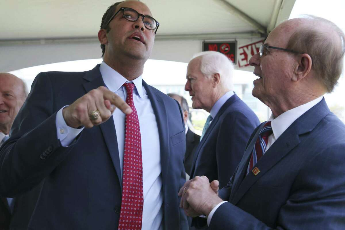 U.S. Rep. Will Hurd, R-San Antonio, left, talks with Bexar County Judge Nelson Wolff before the start of a ground breaking ceremony for the US Courthouse at the former site of the San Antonio Police Department on the 200 block of West Nueva Street, Monday, March 18, 2019. Behind them is U.S. Sen. John Cornyn, R-Texas.